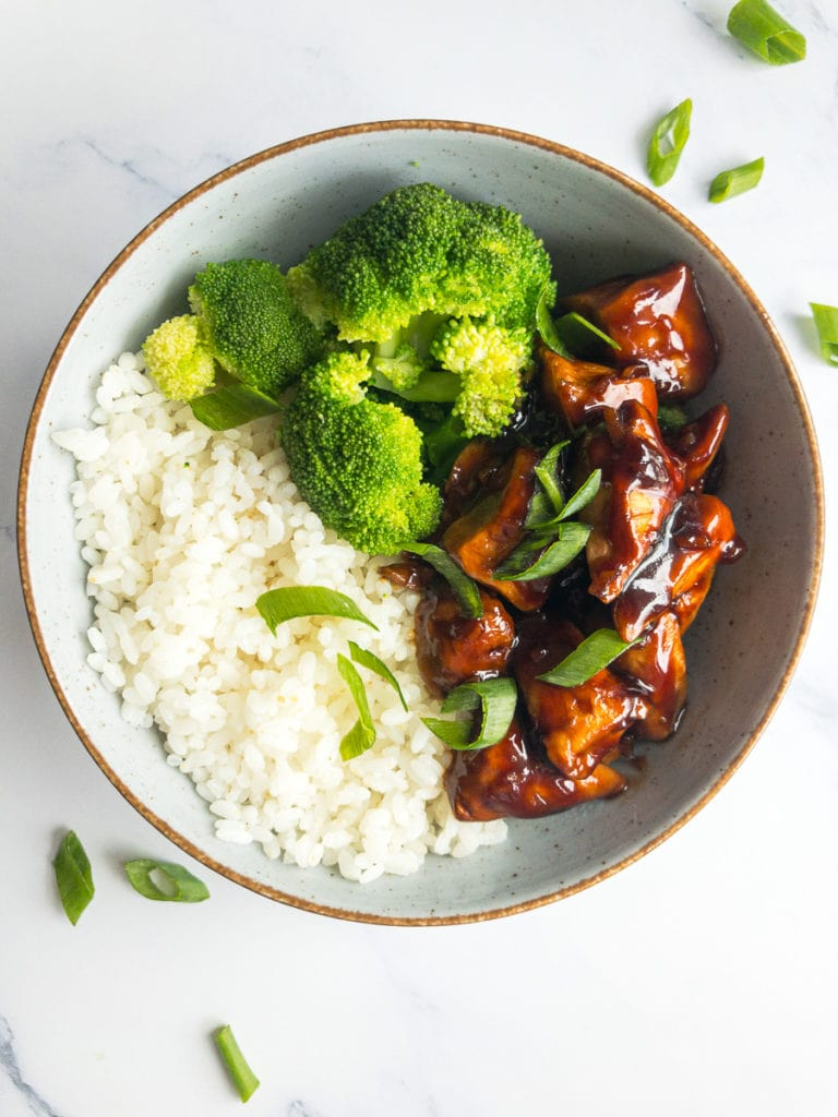 teriyaki chicken with rice and broccoli in a bowl