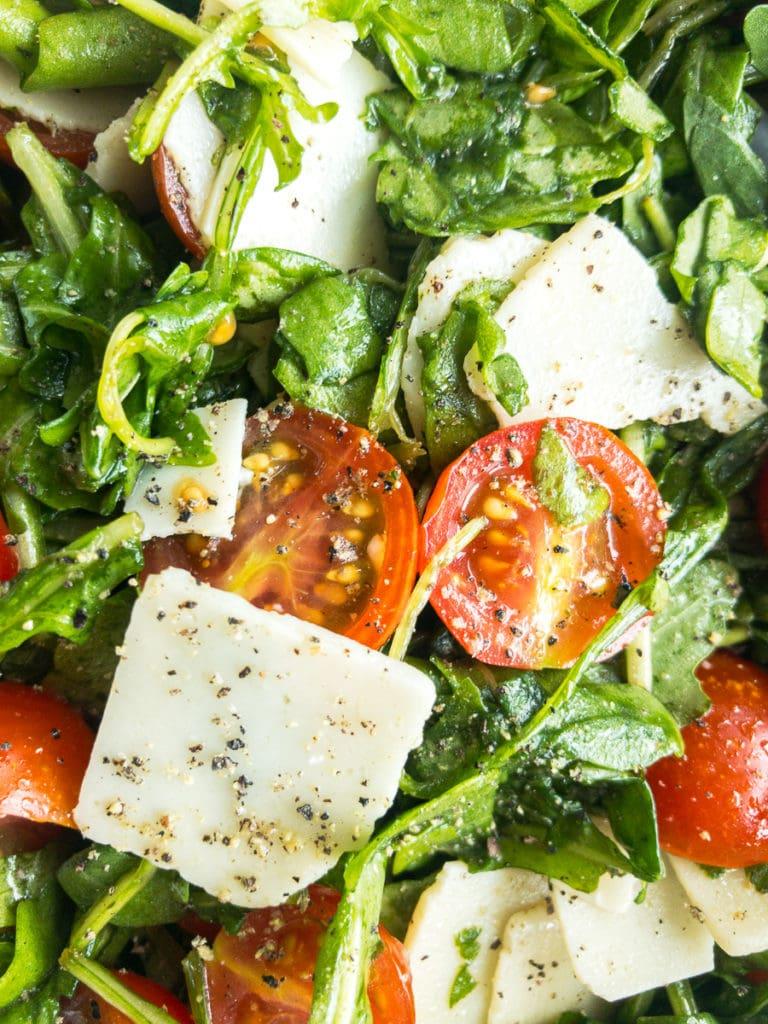 arugula salad with lemon dressing close up
