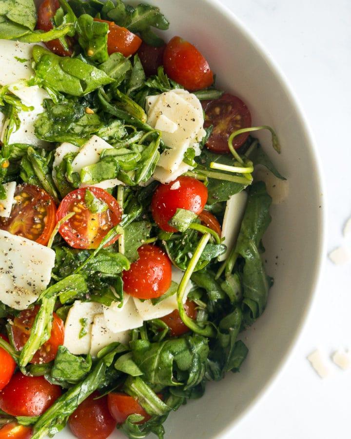 arugula salad with lemon dressing in a bowl