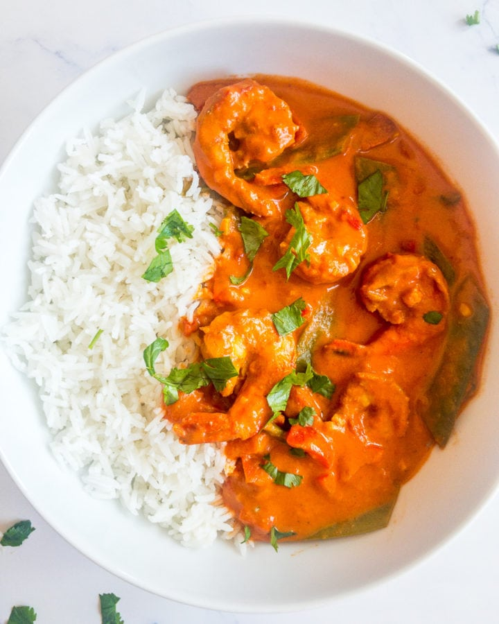 indian shrimp curry with rice in a white bowl