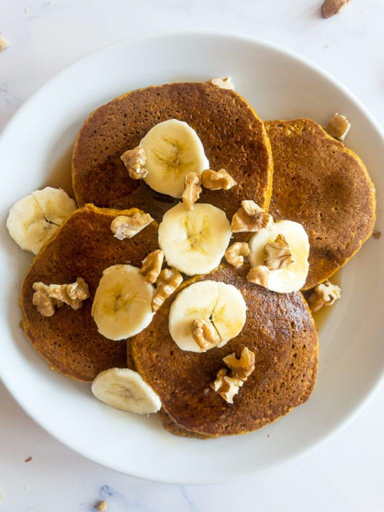 gluten free pumpkin pancakes on a white plate