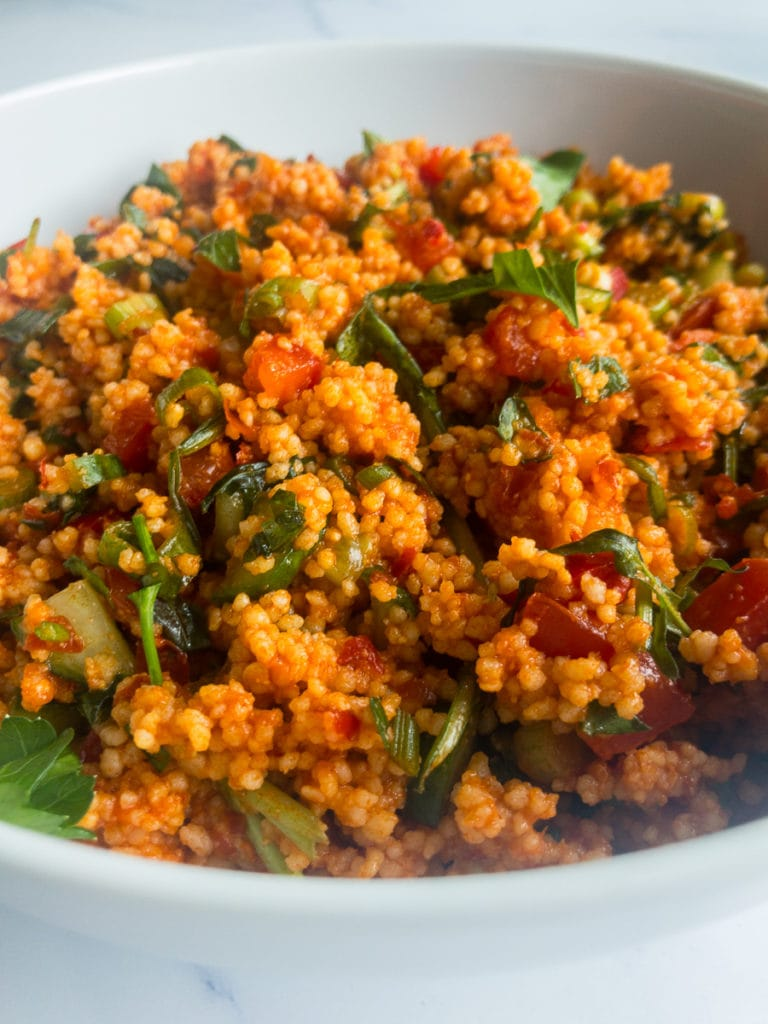kisir turkish bulgur salad in a white bowl