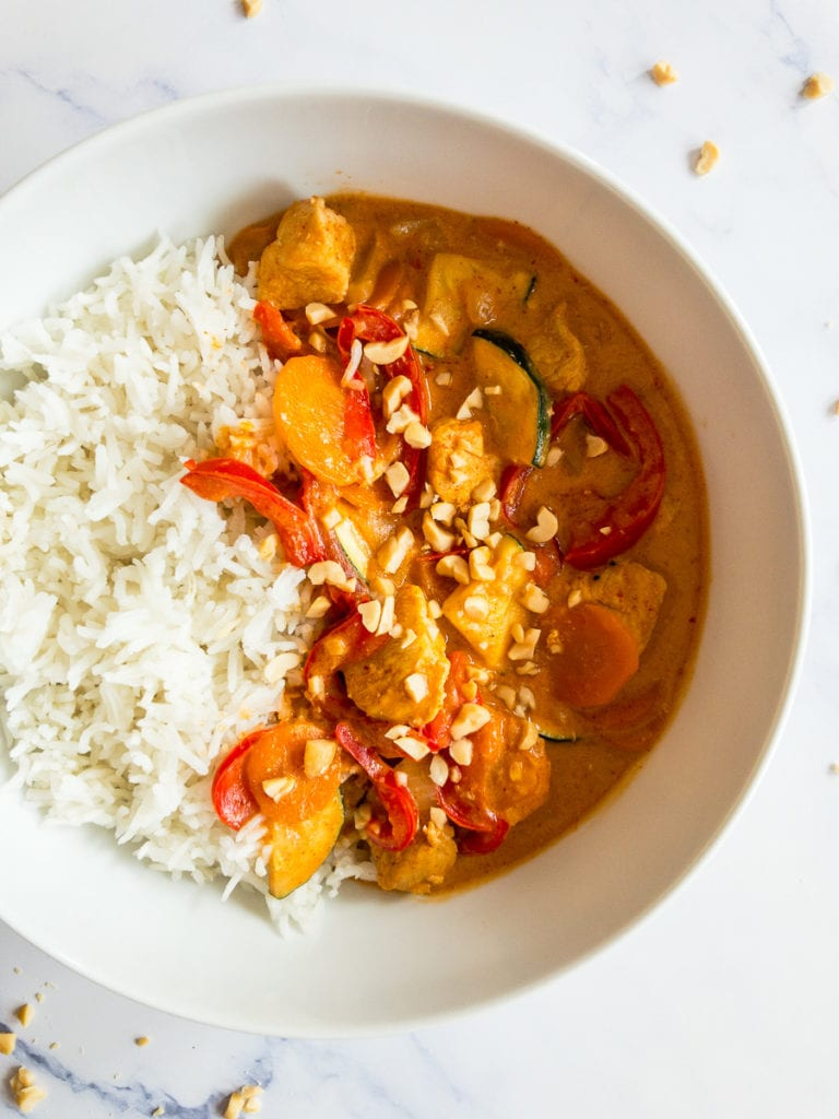 thai peanut cury with chicken in a white bowl