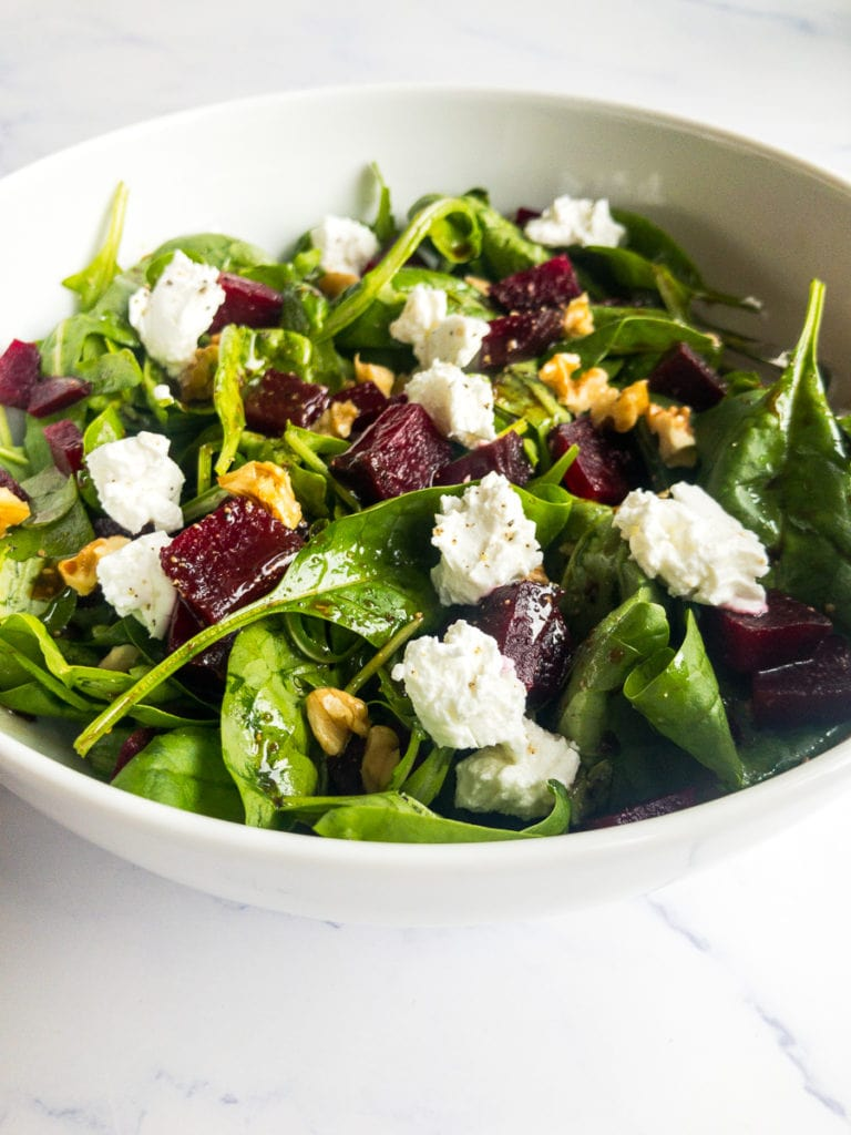 beet and goat cheese salad in a white bowl