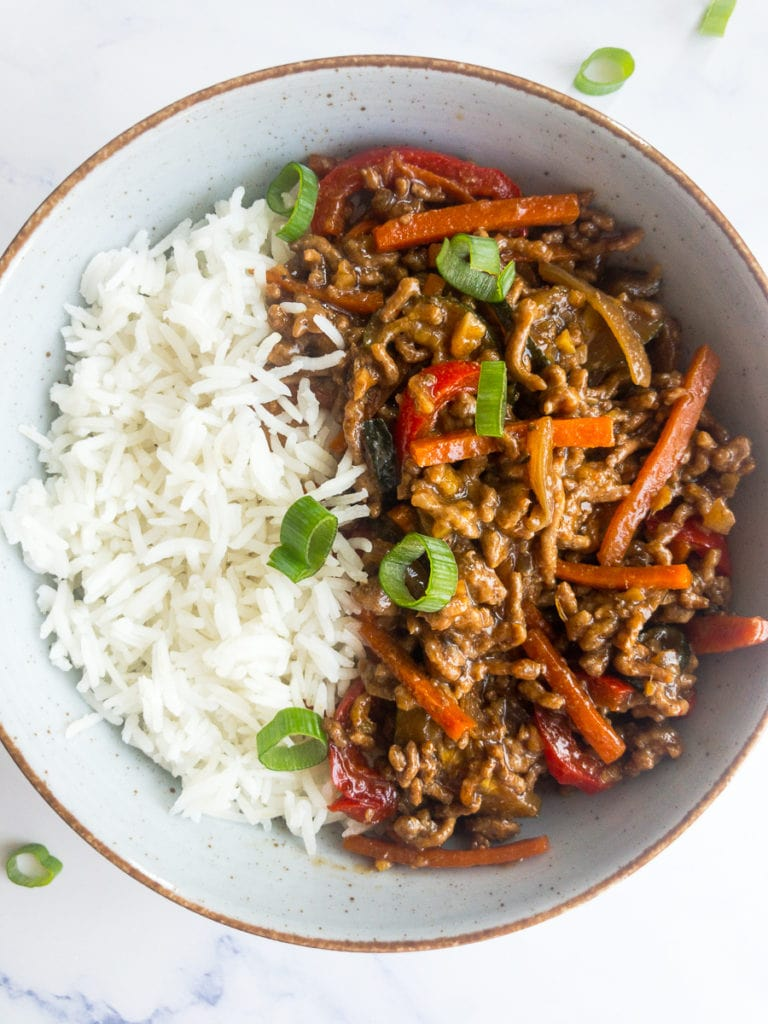 ground beef stir fry with rice in a bowl