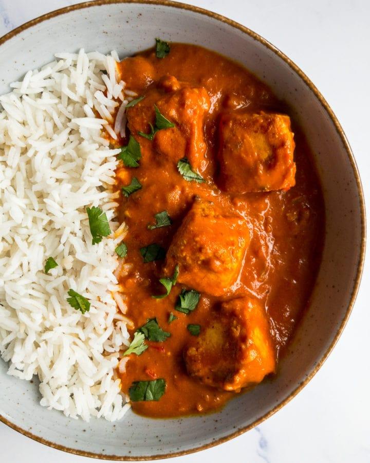 paneer tikka masala and rice in a bowl