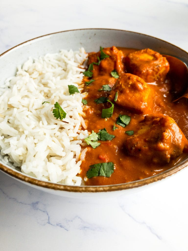 paneer tikka masala and rice in a bowl