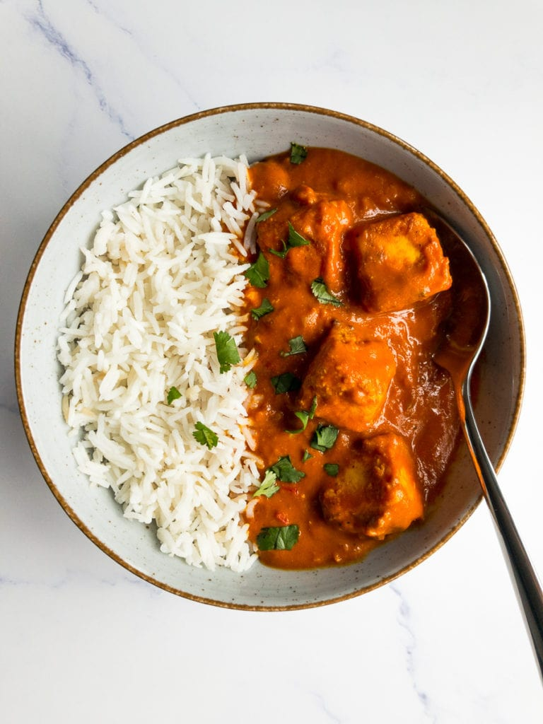paneer tikka masala and rice in a bowl with a spoon
