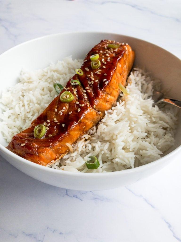 teriyaki salmon in a white bowl