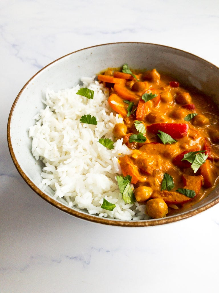 coconut chickpea curry in a bowl with rice