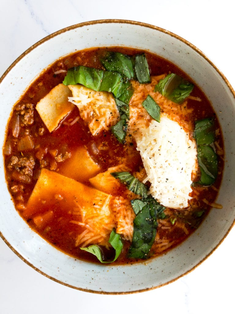 easy lasagna soup with fresh basil in a bowl