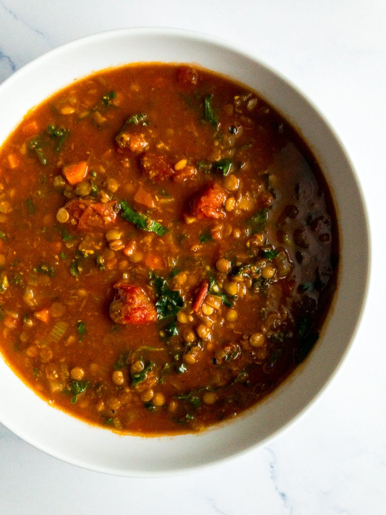 vegetable lentil soup in a white bowl