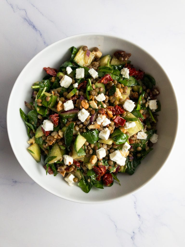 balsamic lentil salad in a white bowl