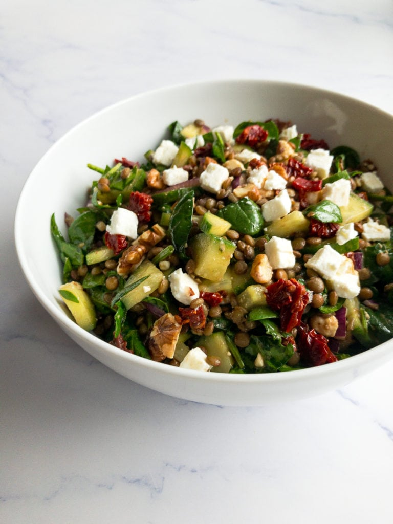 balsamic lentil salad in a white bowl