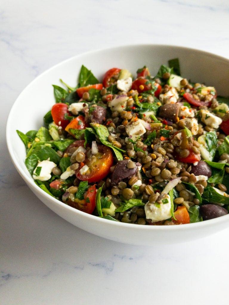 Mediterranean lentil salad in a white bowl
