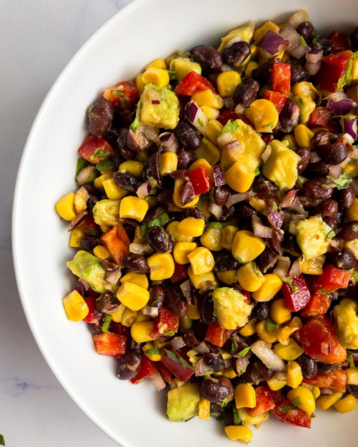 black bean and corn salad in a white bowl