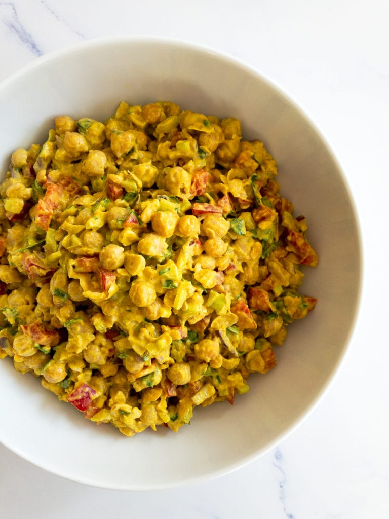 curried chickpea salad in a white bowl