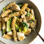 healthy chicken broccoli Alfredo in a bowl with a fork