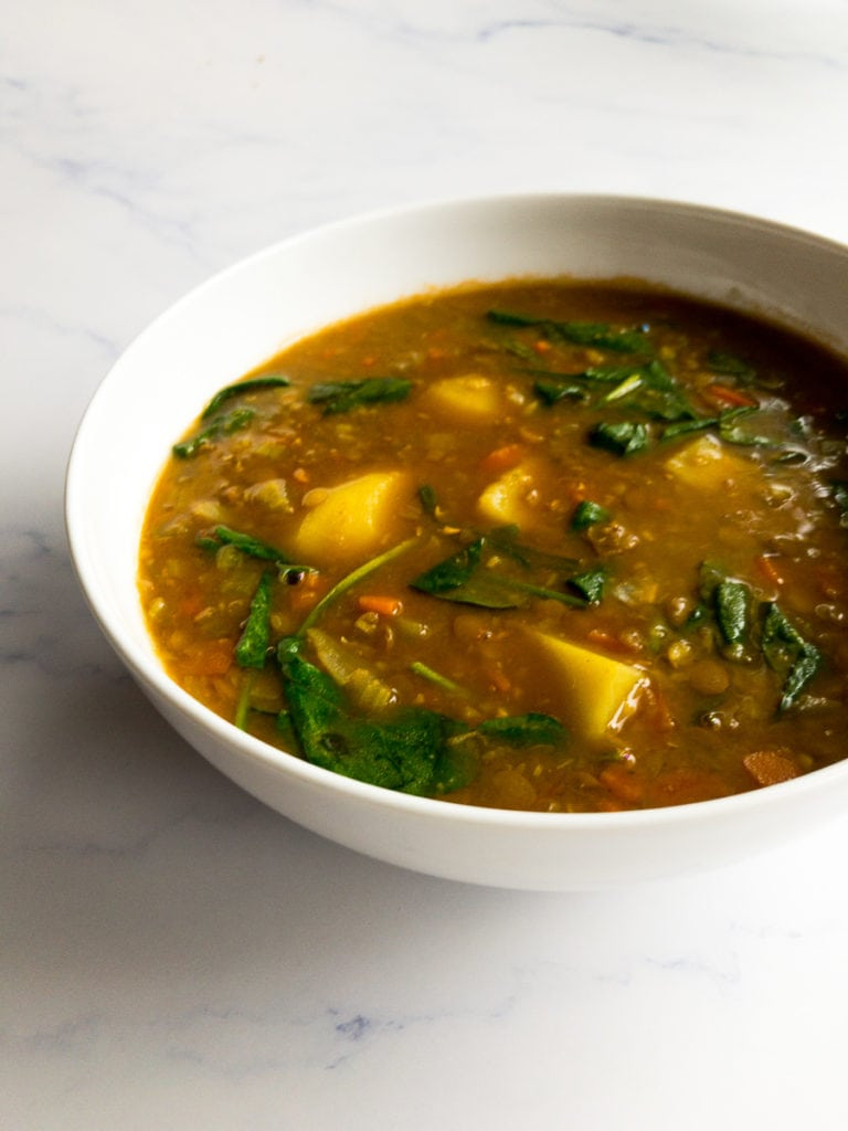 lentil potato soup in a white bowl