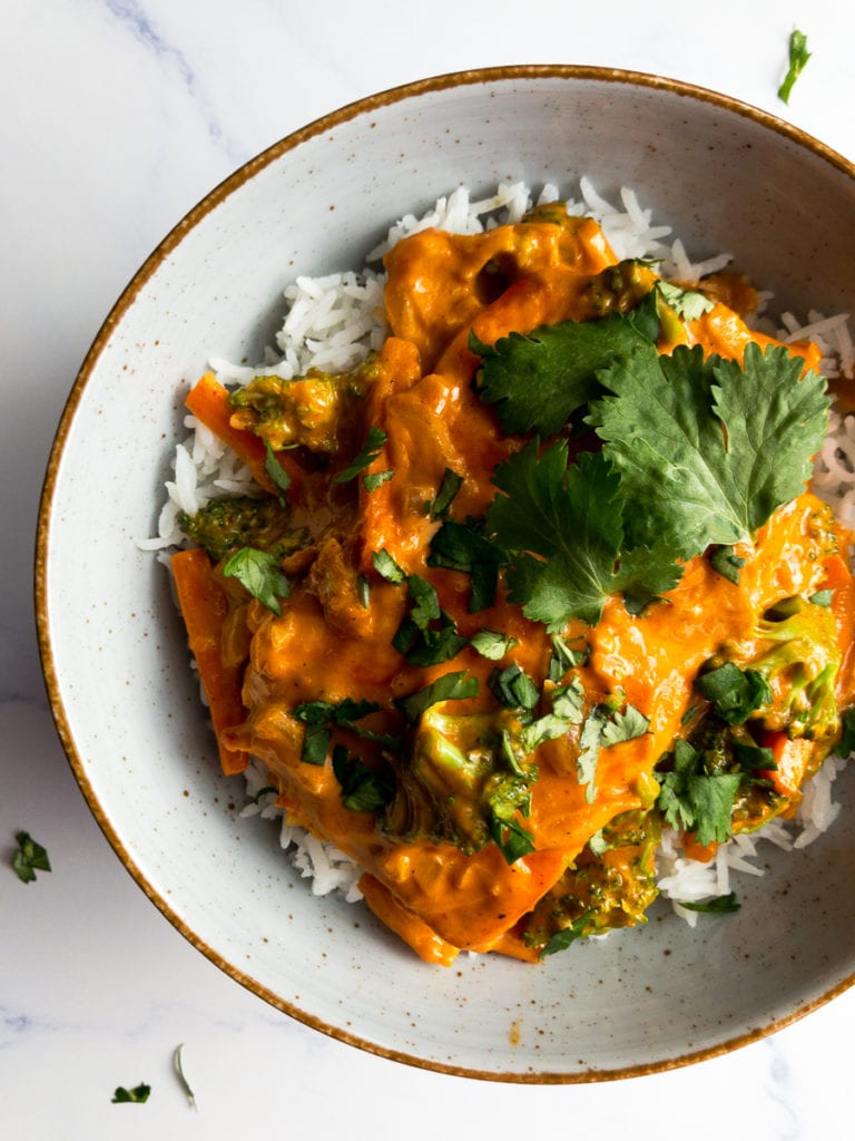 salmon coconut curry on basmati rice topped with cilantro