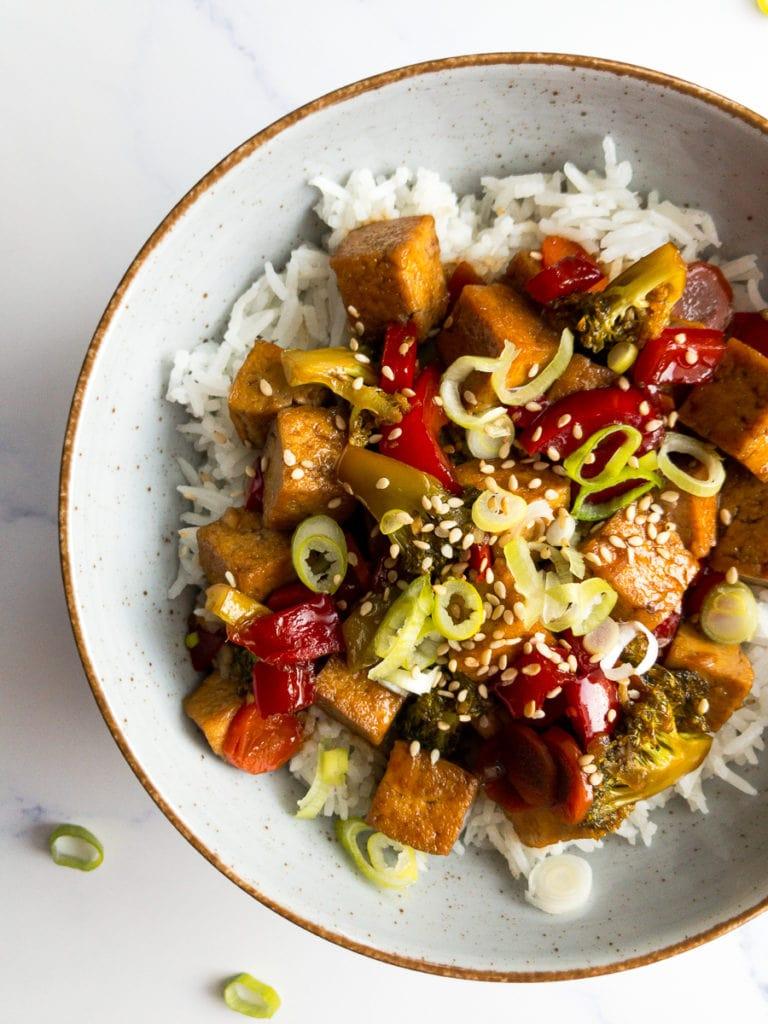 teriyaki tofu stir fry over rice in a bowl