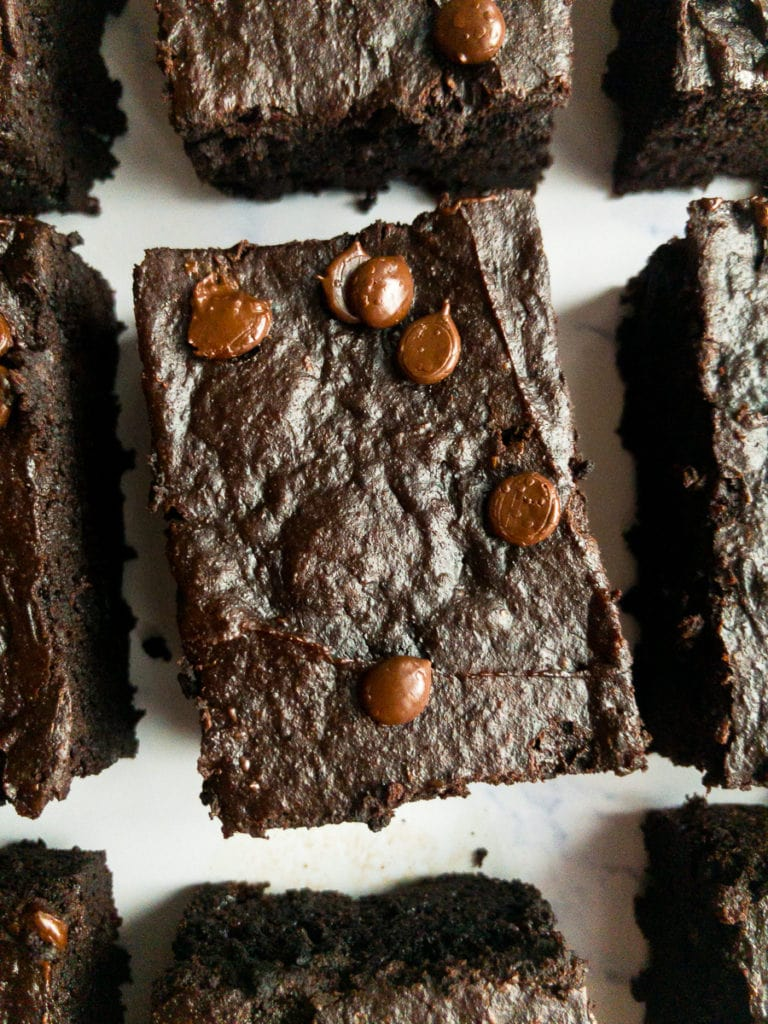 one avocado brownie that is surrounded by other brownies