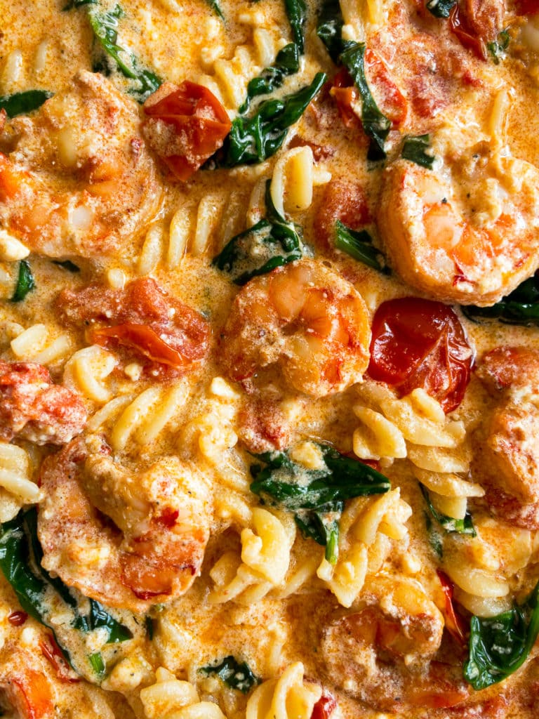 baked feta pasta with shrimp, wilted spinach, cherry tomatoes, basil leaves and garlic