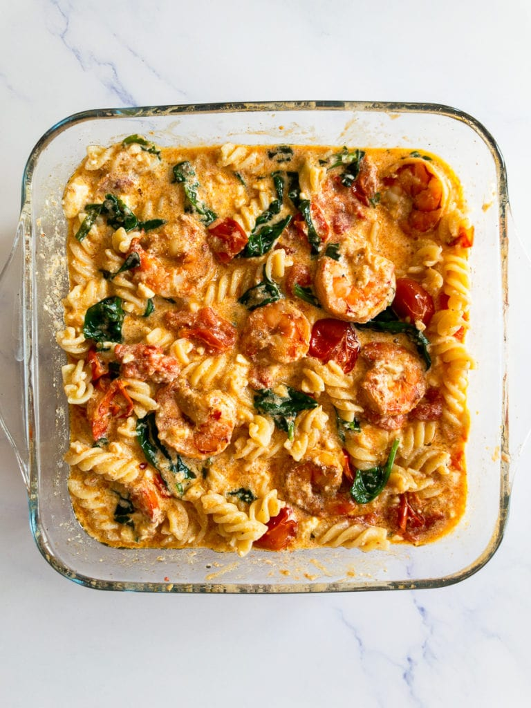 baked feta pasta with shrimp in a baking dish