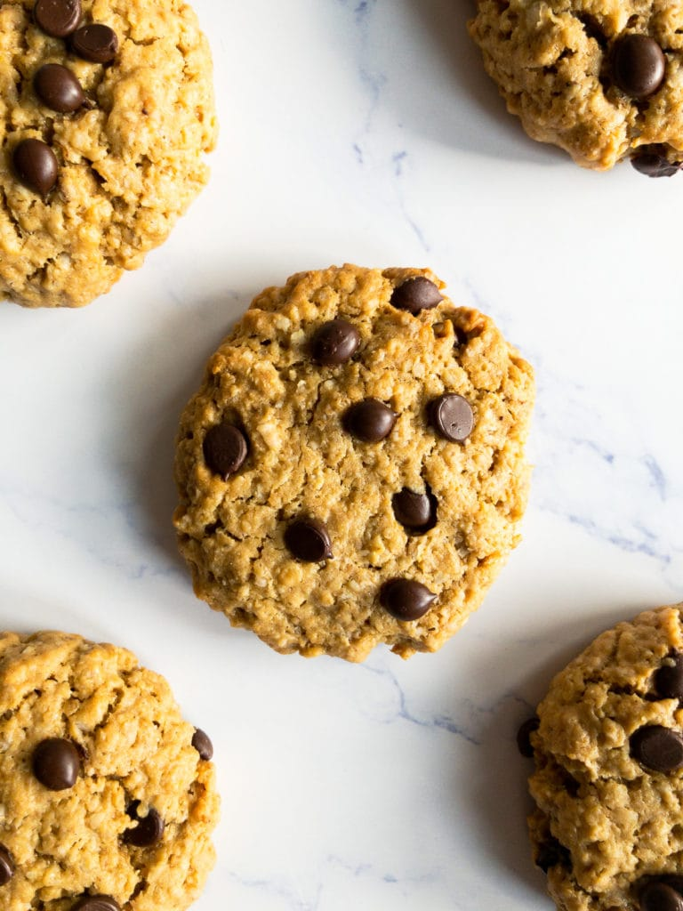 five peanut butter oatmeal chocolate chip cookies on a table