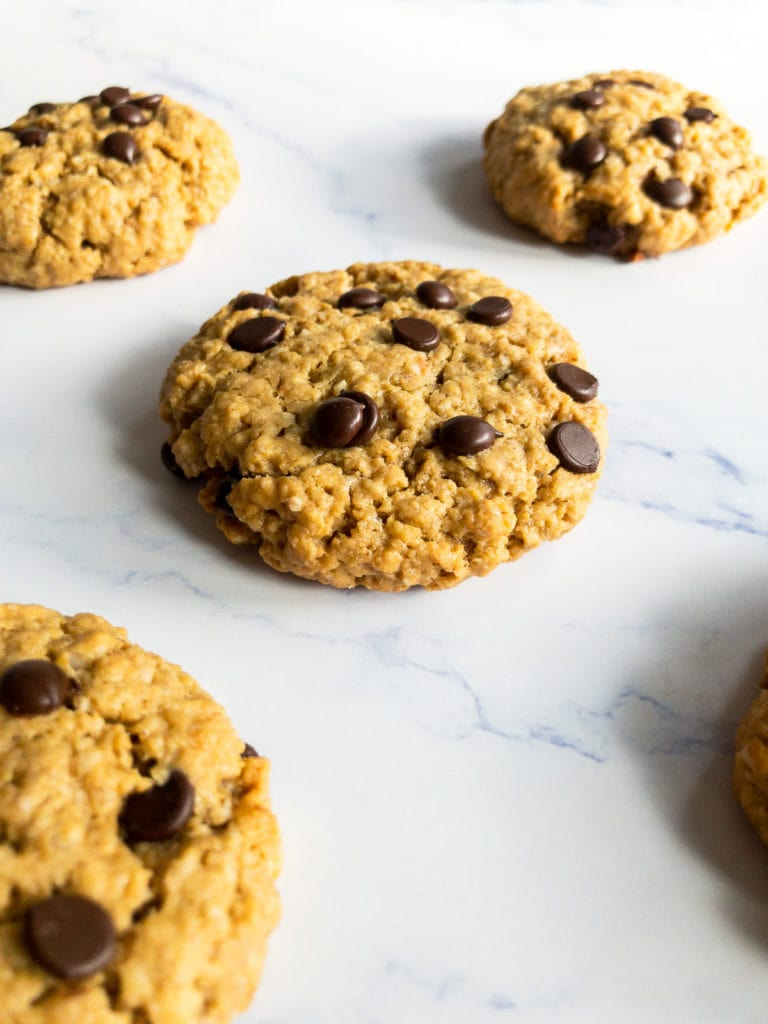 four peanut butter oatmeal chocolate chip cookies on a table