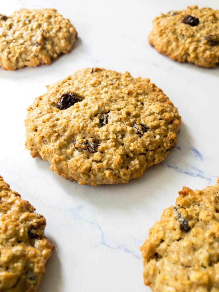 gluten-free oatmeal raisin cookies on a marble table
