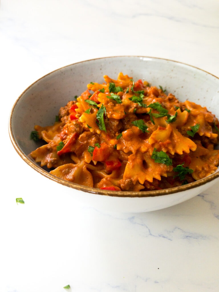 taco pasta garnished with chopped parsley in a bowl
